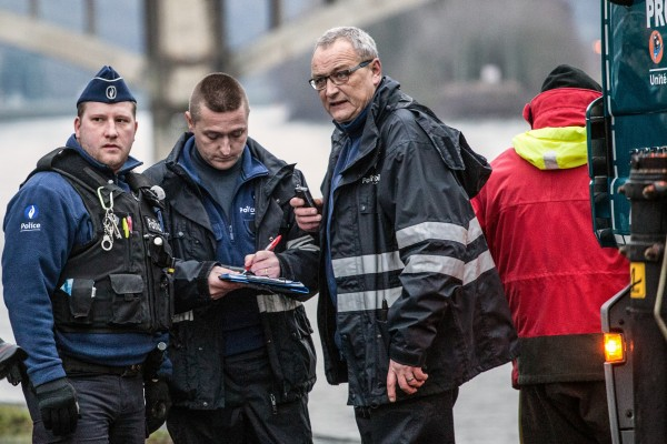20160124 - HUY, BELGIUM: Alain Remue (R) pictured during the search on the river La Meuse in Huy on Sunday 24 January 2016. The stream called 'L'homme sauvage' violently overflowed its banks yesterday around 15:00 and a boy of 12 years old and one Patro youth leader were swept away, in Huy city center, Sunday 24 January 2016. The patro youth leader was found back healthy but the boy is still missing. Philippe BOURGUET/bePress Photo Agency